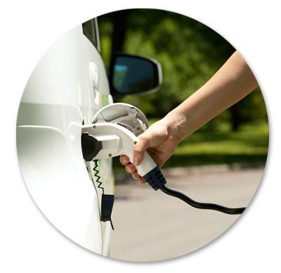 Charging an electric car with solar power.
